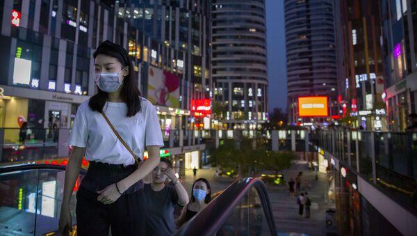 Практически все в Китае сейчас носят медицинские маски - Sputnik Беларусь