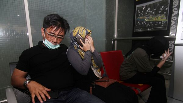 Родственники погибших в авиакатастрофе в Индонезии  - Sputnik Беларусь