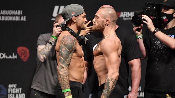Дастин Порье и Конор МакГрегор во время взвешивания UFC 257 в Абу-Даби - Sputnik Беларусь