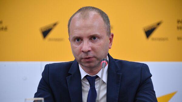Начальник главного управления налогообложения физических лиц Андрей Ковалевский - Sputnik Беларусь