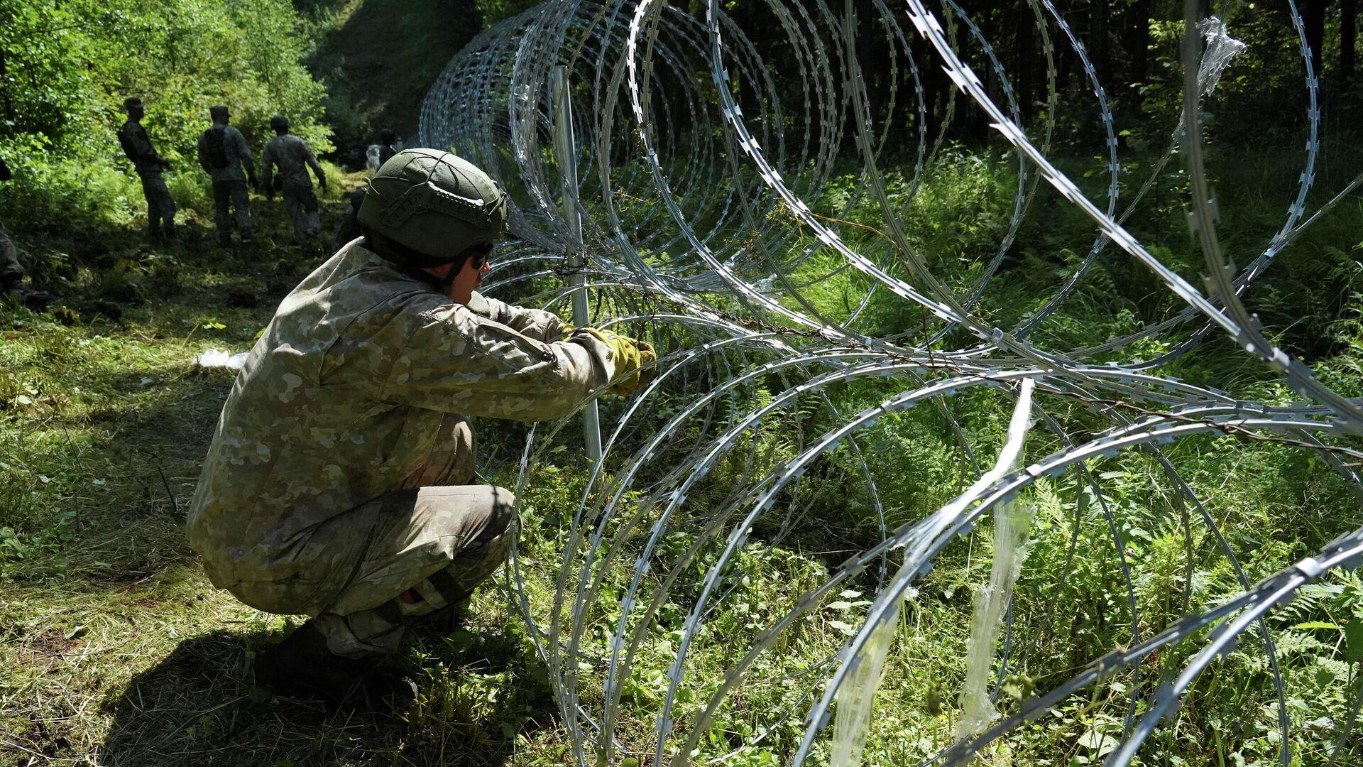 Вслед за Литвой: Эстония построит забор из-за наплыва мигрантов - Sputnik Беларусь, 1920, 27.07.2021