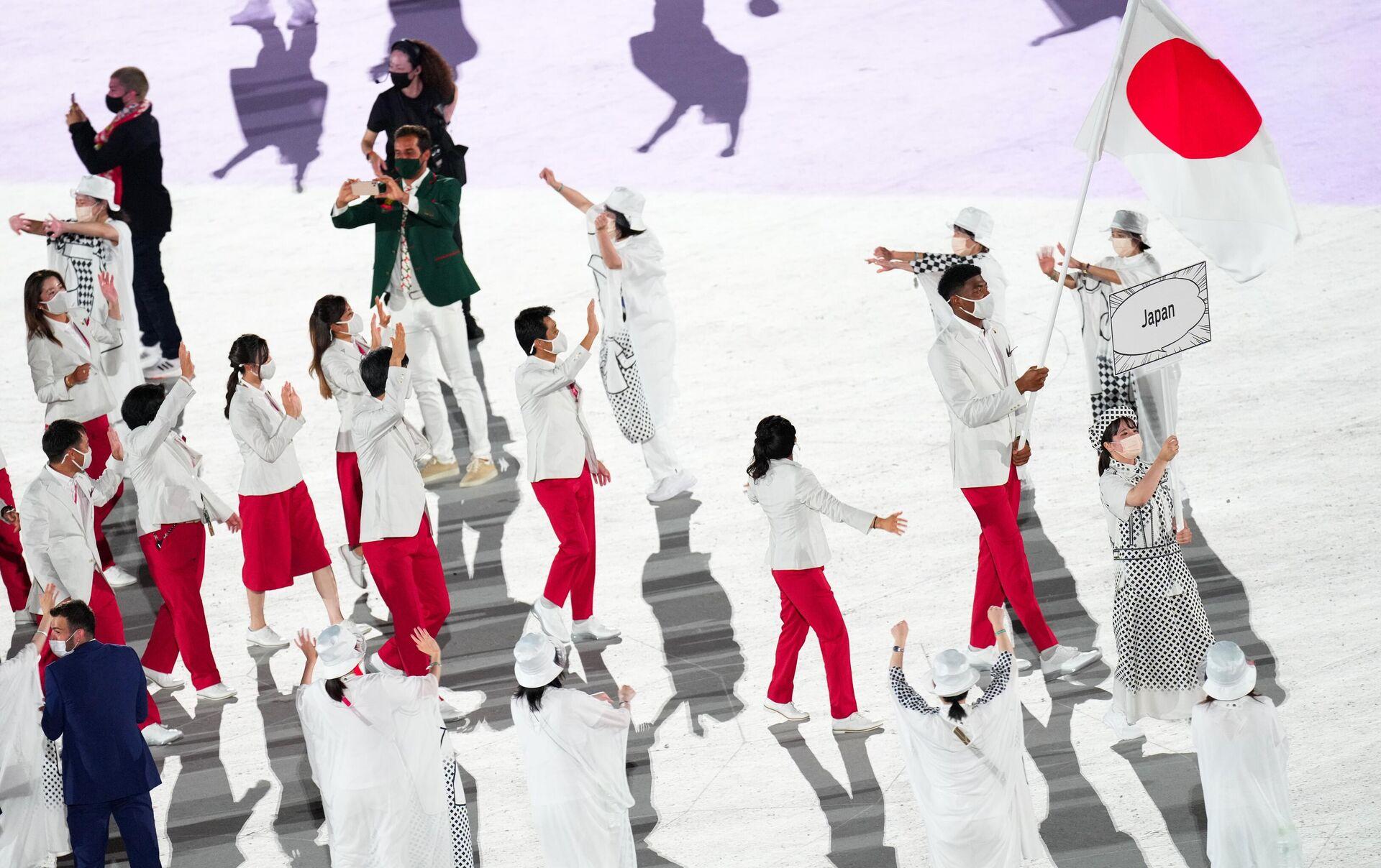 Спортсмены сборной Японии закрывают парад атлетов на Церемонии открытия XXXII летних Олимпийских игр - Sputnik Беларусь, 1920, 23.07.2021