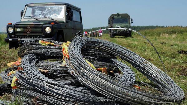 Эстонія падзялілася з Літвой калючым дротам на плот з Беларуссю - Sputnik Беларусь
