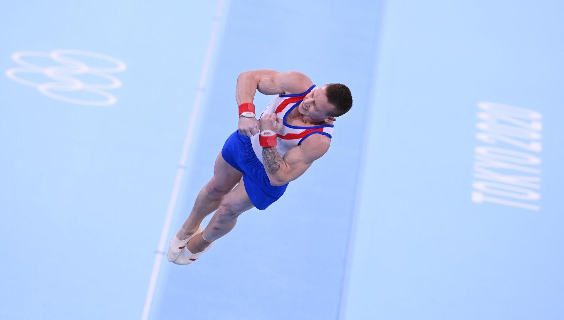 Российский спортсмен Денис Аблязин выполняет опорный прыжок - Sputnik Беларусь, 1920, 26.07.2021