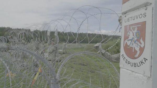 Лекі ад міграцыі? Як будуюць плот на мяжы з Беларуссю - відэа - Sputnik Беларусь