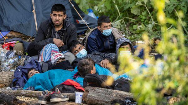 Мигранты на польско-белорусской границе - Sputnik Беларусь