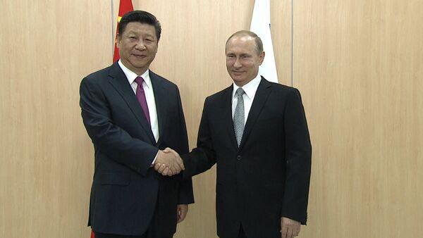 СПУТНИК_Путин и Си Цзиньпин пожали друг другу руки на встрече в Уфе - Sputnik Беларусь