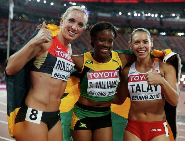Призеры ЧМ по легкой атлетике в Пекине: Синди Роледер, Даниэль Уильямс и Алина Талай (слева направо) - Sputnik Беларусь