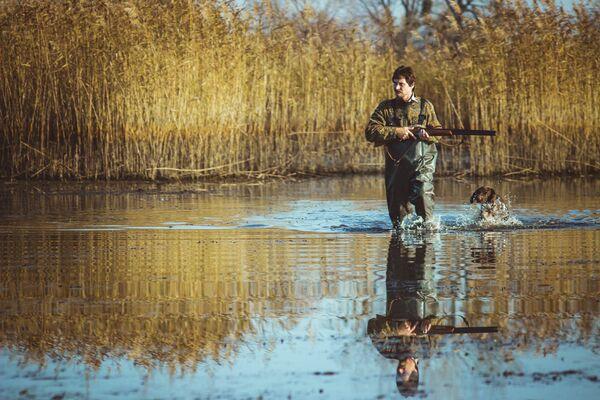 Охотник на озере - Sputnik Беларусь