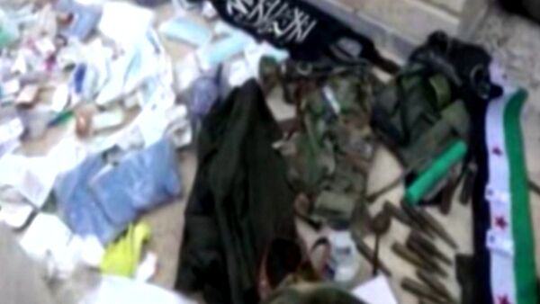 Сирийские военные захватили оружие и форму террористов в Тель-Скеке - Sputnik Беларусь