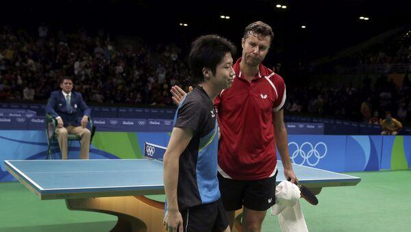 Белорусский теннисист Владимир Самсонов (справа) и японец Дзюн Мидзуки - Sputnik Беларусь
