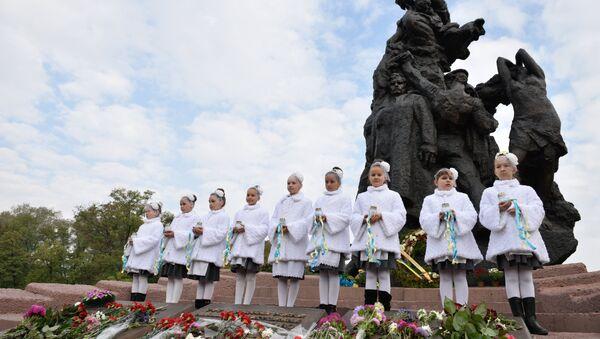 На мерапрыемстве, прысвечаным 75-годдзя трагедыі Баб'ега Яра - Sputnik Беларусь