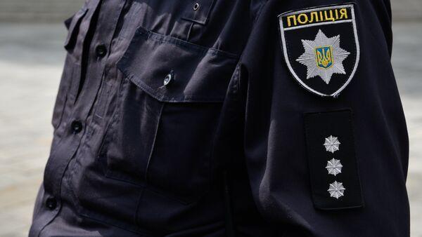 Сотрудник Украинской полиции в Киеве - Sputnik Беларусь