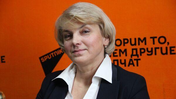 Начальник управления учета и распоряжения акциями ГКИ Анна Корниевич - Sputnik Беларусь