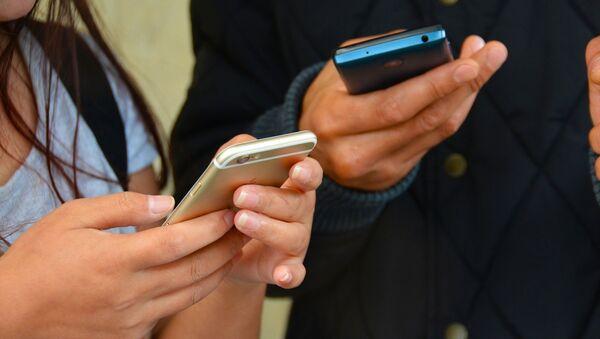 Мобильные телефоны, архивное фото - Sputnik Беларусь