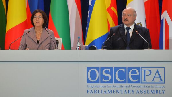 Глава ПА ОБСЕ Кристин Муттонен и президент Беларуси Александр Лукашенко на сессии ПА ОБСЕ - Sputnik Беларусь
