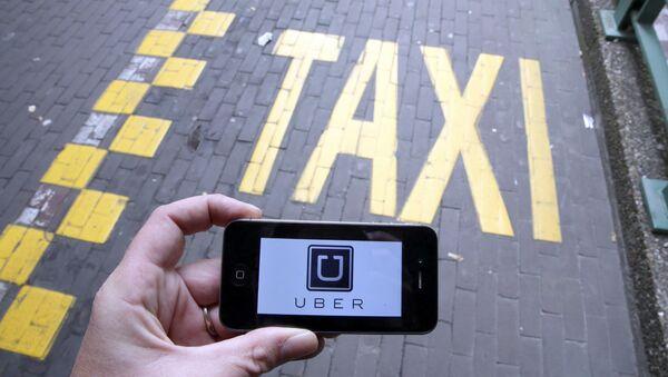 Сервис такси Uber, архивное фото - Sputnik Беларусь