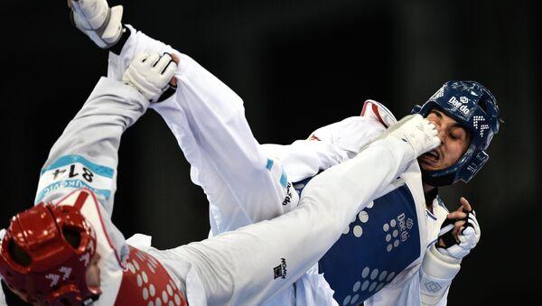 Иван Трайкович (Словения) и Рос Гомес (Испания) в соревнованиях по тхэквондо среди мужчин, архивное фото - Sputnik Беларусь