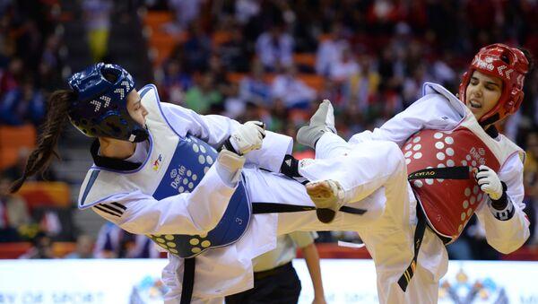 Ирем Яман (Турция) и Марта Карло (Испания) в финале соревнований по таэквондо среди женщин - Sputnik Беларусь