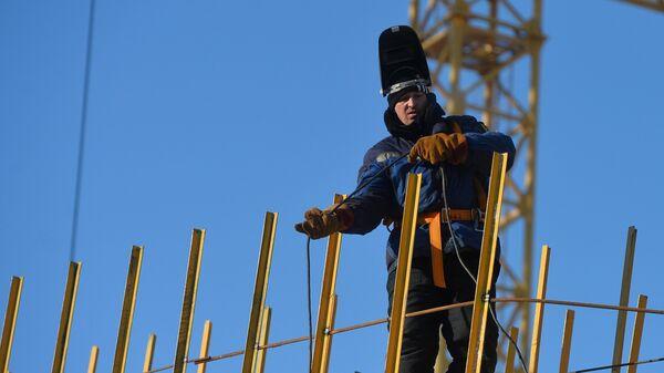 Рабочий на стройке - Sputnik Беларусь