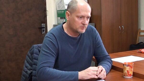 Подозреваемый в шпионаже гражданин Украины Павел Шаройко дает показания в КГБ - Sputnik Беларусь