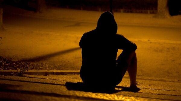 Молодой человек в депрессии, архивное фото - Sputnik Беларусь