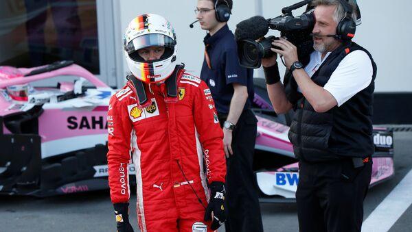 Немецкий гонщик команды Ferrari Себастьян Феттель - Sputnik Беларусь