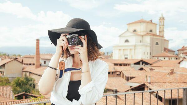 Турист с фотоаппаратом - Sputnik Беларусь
