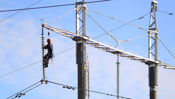 Работа электрика, архивное фото - Sputnik Беларусь
