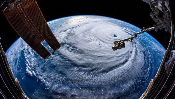 Ураган Флоренс, сфотографированный астронавтом Александром Герстом с МКС - Sputnik Беларусь