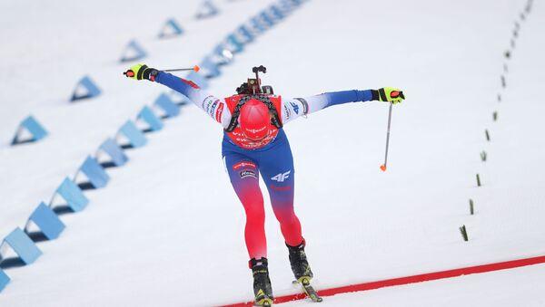 Анастасия Кузьмина (Словакия) на финише масс-старта среди женщин на третьем этапе Кубка мира по биатлону сезона 2018/19 в чешском Нове-Место - Sputnik Беларусь