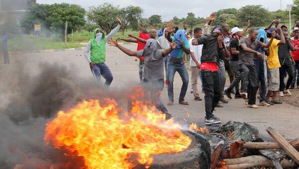 Протесты в Хараре, Зимбабве, в январе 2019 - Sputnik Беларусь