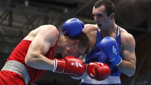 Боксеры Муслим Гаджимагомедов (Россия) и Владислав Смягликов (Беларусь) - Sputnik Беларусь
