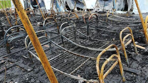 Последствия пожара в палаточном городке на территории горнолыжного комплексаХолдоми в Солнечном районе Хабаровского края - Sputnik Беларусь