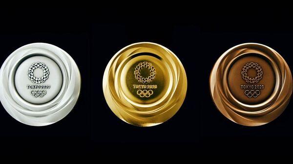 МАК паказаў медалі, якія ўручаць на Алімпіядзе-2020 у Токіа - відэа - Sputnik Беларусь