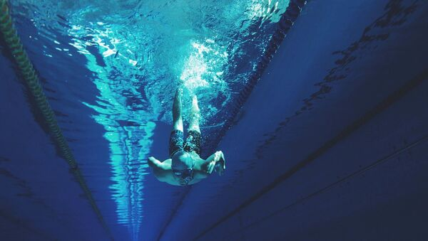 Пловец в бассейне, архивное фото - Sputnik Беларусь
