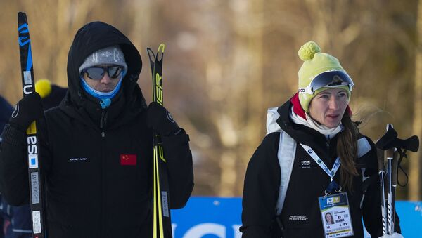 Тренеры национальной сборной Китая по биатлону Уле-Эйнар Бьорндален и Дарья Домрачева - Sputnik Беларусь