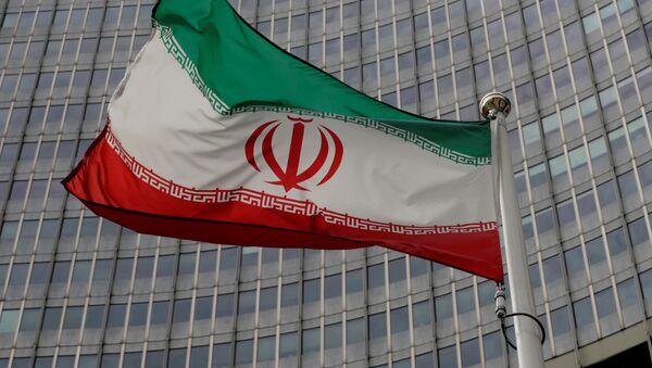 Флаг Ирана перед штаб-квартирой МАГАТЭ в Вене - Sputnik Беларусь