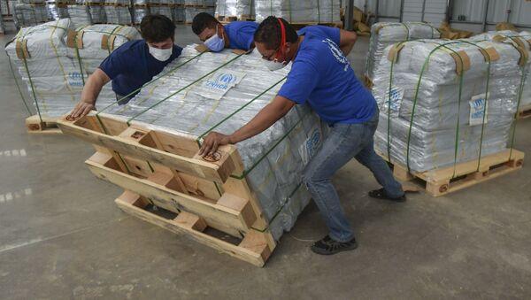 Сотрудники Организации Объединенных Наций организуют доставку гуманитарной помощи - Sputnik Беларусь