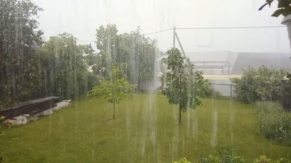 Жара и дождь - какой была погода в Минске и районе в субботу, видео - Sputnik Беларусь